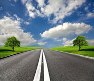 Go ahead. Country road and green fields Stock Image