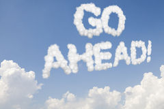 Go ahead concept text in clouds Stock Images