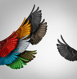 Go It Alone. Concept and Independent thinker idea or new leadership concept and individuality as a group of united flying bird wings with one individual wing stock illustration