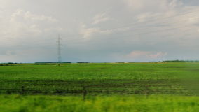 Go along the agricultural area of Hungary. View from the window of a fast traveling bus or car stock footage