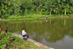 Go angling. A lake in the park sat few anglers Stock Photo