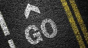 Go and arrow. On the asphalt road stock photos