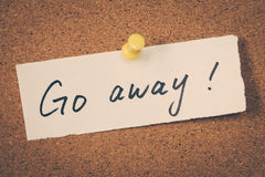 Go away. Note pinned on the bulletin board Royalty Free Stock Photography