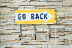Go back sign on the wall Royalty Free Stock Image