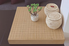Go board game on a table Stock Photos