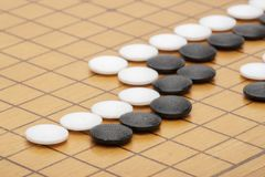 Go board,traditional Chinese strategy board game.Game brain training royalty free stock photos