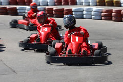 Go cart race. Rs struggling at the piste royalty free stock image