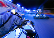 Go-Kart Race. Two go-carts racing close to each other on an indoor race track Stock Photography