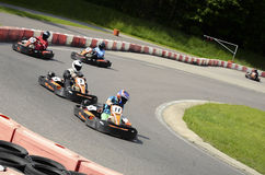 Go cart racers. Go kart racers going fast in to the corner Royalty Free Stock Photos