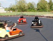 Go Carts. Mini Racing Cars taking curve Royalty Free Stock Photos