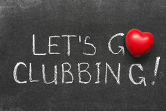 Go clubbing. Lets go clubbing phrase handwritten on blackboard with heart symbol instead of O Royalty Free Stock Photography