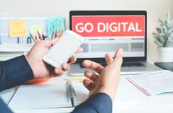 Go digital marketing concepts ideas with person working with smartphone and laptop.Business communication. And key to success royalty free stock image