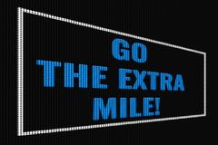 Go The Extra Mile blue text on dark screen. Go The Extra Mile blue  text on dark screen, tv effect stock illustration