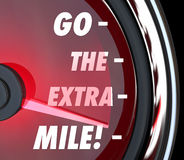 Go the Extra Mile Speedometer Words Further Extended Driving Eff. Go the Extra Mile words on a speedometer with needle racing to illustrate extended effort in vector illustration