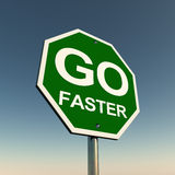 Go faster. On a green road sign against a blue sky, concept of a clear day to make hay Stock Photography