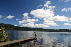 Go fishing. Fishing by the lake, New Zealand royalty free stock photography
