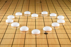 Go game. A heart on Go game board Stock Images