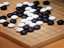 Go game. Board of go with black and white pieces royalty free stock image