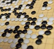 GO game. GO is an abstract strategy board game for two players, in which the aim is to surround more territory than the opponent Royalty Free Stock Photo