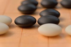 GO game. GO is an abstract strategy board game for two players, in which the aim is to surround more territory than the opponent Royalty Free Stock Image