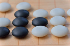 GO game. GO is an abstract strategy board game for two players, in which the aim is to surround more territory than the opponent Stock Image