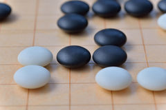 GO game. GO is an abstract strategy board game for two players, in which the aim is to surround more territory than the opponent Royalty Free Stock Photos