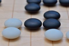 GO game. GO is an abstract strategy board game for two players, in which the aim is to surround more territory than the opponent Stock Photography