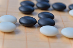 GO game. GO is an abstract strategy board game for two players, in which the aim is to surround more territory than the opponent Stock Images