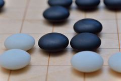 GO game. GO is an abstract strategy board game for two players, in which the aim is to surround more territory than the opponent Stock Photos