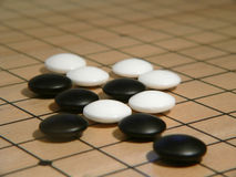 Go Game on board. Go game in play Royalty Free Stock Images