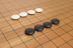 Go game board. With black and white stones Royalty Free Stock Photography