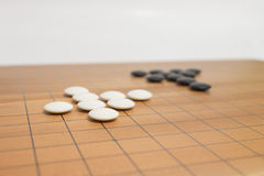 Go game board. With black and white stones Stock Images