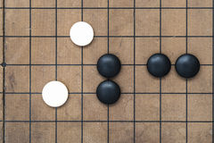 Go game board. Traditional chinese game. Weiqi game board. Stones on a Go board Royalty Free Stock Photography