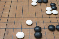 Go game board. Weiqi game board. Stones on a Go board Stock Photos