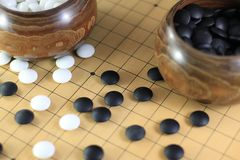 GO-Game with pieces an boxes Stock Image