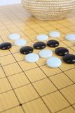 Go game in play. Features on the game of go, to play a game of go chess royalty free stock photo