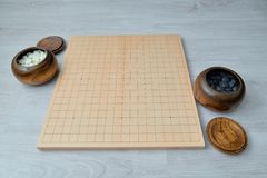 Go game set. Go is an abstract strategy board game for two players, in which the aim is to surround more territory than the opponent Stock Photo