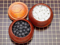Go game stones in wooden bowls Stock Photo