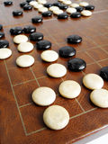 Go game or Weiqi - ancient chinese chess game. Cornered! - An image of an traditional ancient chinese chess game board. Game is called Weiqi, or Go. Layout of Stock Photography
