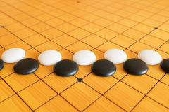 Go game or Weiqi Chinese board game. Background Stock Image