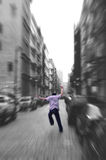 Go Get That Pigeon. Black and white zoom blur - with the running man running isolated in color Stock Photos