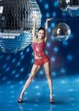 Go-Go dancer girl. With disco balls over blue background stock photos