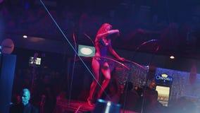 Go go girl in bikini dance at stand. Dj spinning at turntable in nightclub. stock video