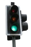Go Go Go. Traffic lights at green for go, isolated against a white background Stock Images