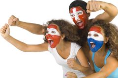Go! Go! Go!. Small group of screaming, international sport's fans with painted flags on faces and with clenched fists. Side view, white background Stock Photos