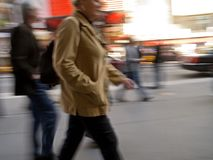 Go Go Go. A motion blur of a woman and others walking down a busy Manhattan street Stock Images