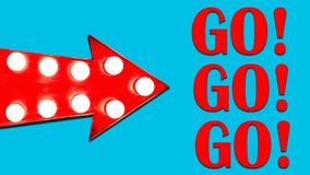 Go, Go, Go and Red arrow shaped vintage colorful illuminated metallic display direction sign with glowing light bulbs isolated. Red arrow shaped vintage colorful royalty free stock image