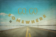 Go, go somewhere. Inspirational quote go, go somewhere on picture of a desert road during winter season in Canada Royalty Free Stock Photos