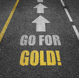 Go for gold road markings. Conceptual go for gold road markings with directional arrows Royalty Free Stock Images