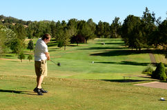 Go Golfing. Golfer enjoying the links on a late summer afternoon in Oregon Stock Image